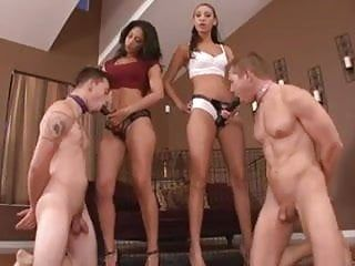 2 females have pleasure pegging 2 males.